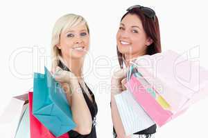 Cute well-dressed women with shopping bags