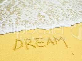 dream word written in the sandy beach