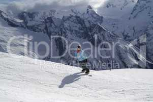 Snowboarder on ski slope