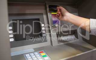 Hand inserting a credit card