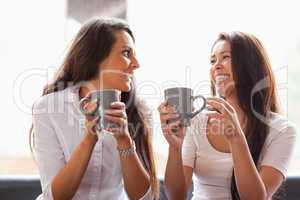Laughing friends having a coffee