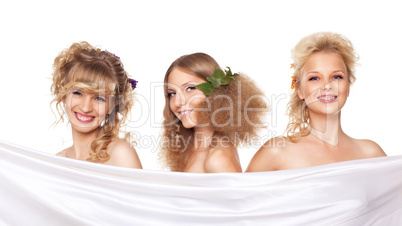 Three young woman with flower hair style