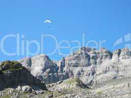 Paraglider Over The Mountains Of Glarus