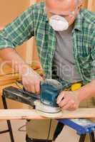Handyman sanding wooden board diy home renovation