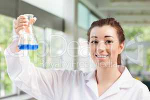 Cute science student holding an Erlemeyer flask