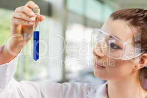 Female science student looking at a test tube