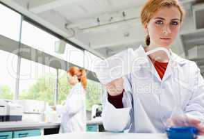 Female science students working