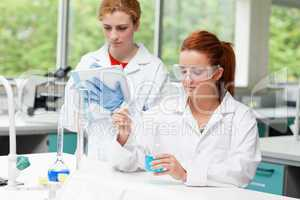 Science students doing an experiment