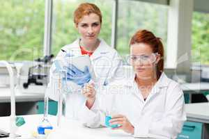 Cute science students doing an experiment