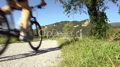 Young man training and racing on mountain bike