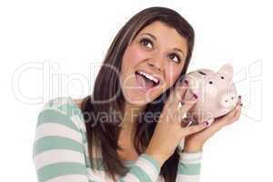 Ethnic Female Daydreaming and Holding Pink Piggy Bank