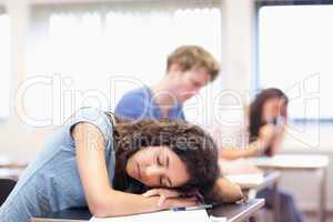 Student sleeping on her desk
