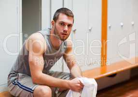Young sports student sitting on a bench