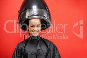 Woman under a hairdressing machine