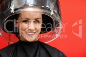 Student under a hairdressing machine