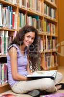 Portrait of a female student with a book