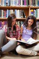 Portrait of female students reading