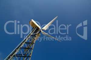 The wind generator against the blue sky