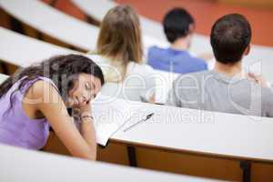 Young student sleeping during a lecture