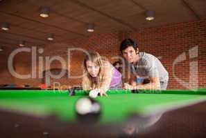 Man teaching pool to his girlfriend
