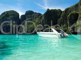 Motor boat on turquoise water of Indian Ocean, Phi Phi island, T