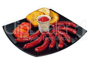 Plate with grilled sausages and ketchup