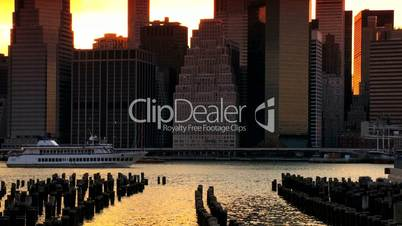 Sunset over the Hudson River with Ferry, Manhattan Financial District, NY, USA