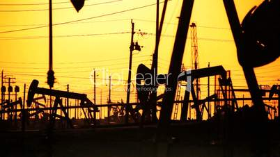 Oil Drilling in Silhouette at Sunset