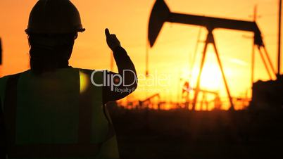 Female Oil Production Engineer with Cell Phone
