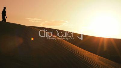 Female Trekking in Desert Environment