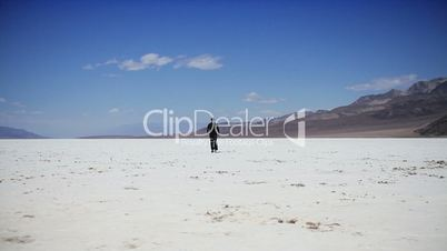 Walking Across Barren Dry Salt Lake