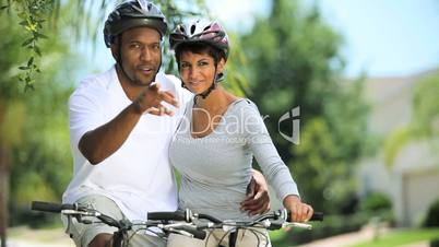 African American Couple Cycling Exercise