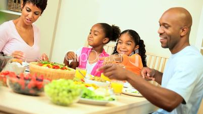 African American Family Enjoying a Healthy Lunch Together