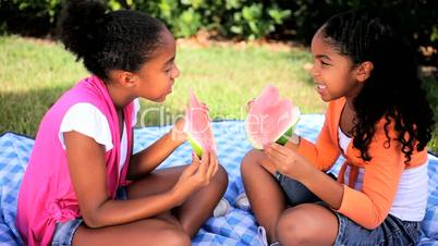 Cute Little Ethnic Girls Eating Water Melon