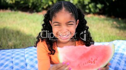 Little Ethnic Girl Enjoying Watermelon