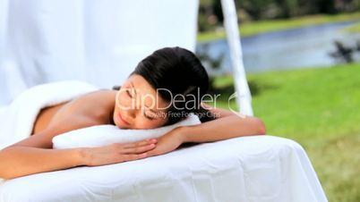 Beautiful Asian Girl Having Hot Stone Massage Therapy