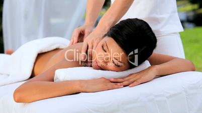 Asian Girl Enjoying Spa Massage