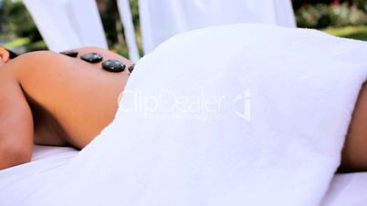 Asian Girl Relaxing with Hot Stone Massage