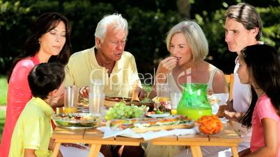 Extended Family Group Sharing Healthy Lunch