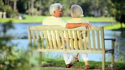 Retired Couple on Park Bench Enjoying the View