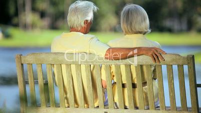 Older Couple on Park Bench Enjoying the View