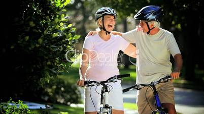 Retirement Cycling Exercise by Healthy Senior Couple