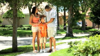 Young Ethnic Family Walking Home Together
