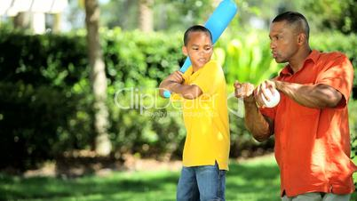 Ethnic Father Teaching Young Son Baseball