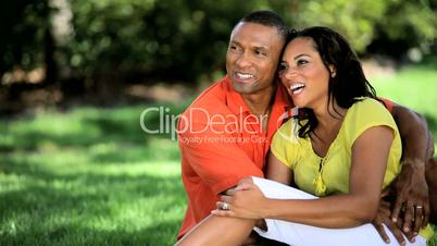 Attractive Ethnic Couple Relaxing Outdoors Together