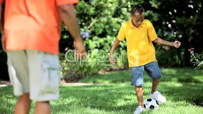 Healthy Ethnic Father & Son with a Football
