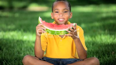 Young Ethnic Boy Eating Healthy Water Melon