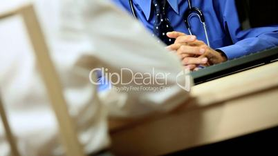 Senior Male Consultant with Patient