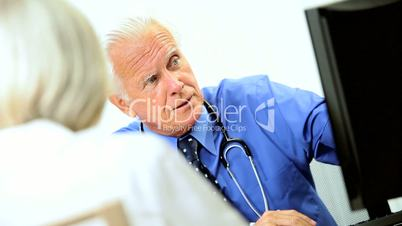 Senior Male Medical Consultant with Patient