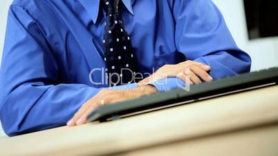 Senior Male Business Consultant at His Desk